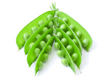Peas. The isolated opened pods of peas on a white background Royalty Free Stock Images