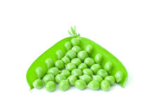 Peas. The isolated opened pods of peas in the form of a triangle Stock Photos
