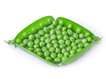 Peas. The isolated opened pods of peas in the form of a rhombus Stock Image