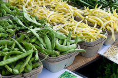 Peas and Beans. Multiple Green Pea Pods and Yellow Wax Beans in Baskets Royalty Free Stock Image
