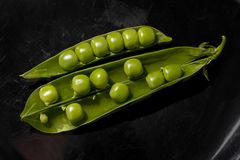 Peas on Black Background Royalty Free Stock Images