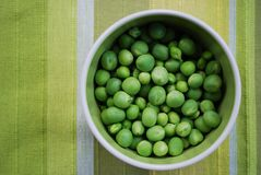 Peas in a bowl royalty free stock photo