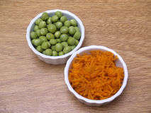 Peas and carrot. Photography in the foreground Royalty Free Stock Image