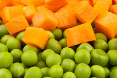 Peas and carrot mix. Full frame closeup royalty free stock image