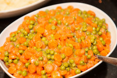 Peas and carrots Stock Photos