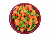 Peas and carrots in dish Stock Image