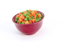 Peas and carrots in dish Stock Photos