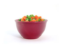 Peas and carrots in dish Stock Images
