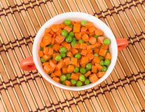 Peas and carrots in plate. Royalty Free Stock Image