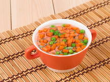 Peas and carrots in plate. Stock Image