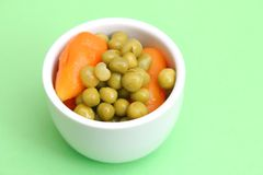 Peas and carrots Stock Photography