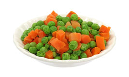 Peas and carrots in white dish Royalty Free Stock Photography