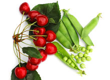Peas and cherries Stock Image
