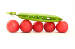 Peas on cherries. The photograph represent some peas on several cherries isolated on white background Stock Image