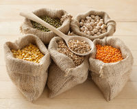 Peas, chick peas, red lentils, wheat and green mung Royalty Free Stock Image