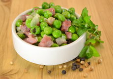 Peas cooked with ham and herbs Stock Photography