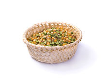 Peas, corn, buckwheat in a basket Stock Images