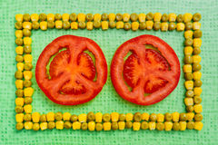 Peas corn tomato background Stock Photography