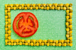 Peas corn tomato background Royalty Free Stock Photo