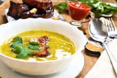 Peas cream soup with smoked ham royalty free stock images
