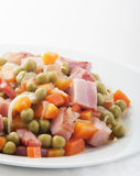 Peas with diced ham Stock Photos