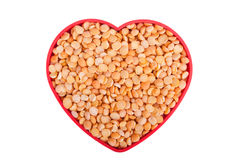 Peas in a dish in the shape of a heart Stock Photo