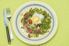 Peas with eggs and ham. Cooked eggs on peas Royalty Free Stock Images