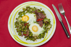 Peas with eggs and ham. Cooked eggs on peas Stock Photography
