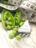 Peas on the fork Royalty Free Stock Image