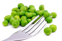 Peas on fork. Royalty Free Stock Image