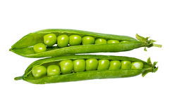 Peas in a green pod isolated Stock Images