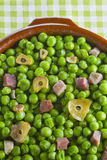 Peas with ham Stock Photography