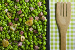 Peas with ham Royalty Free Stock Images