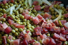 Peas with ham Royalty Free Stock Photo