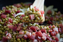 Peas with ham Royalty Free Stock Photos
