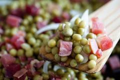 Peas with ham Stock Photography