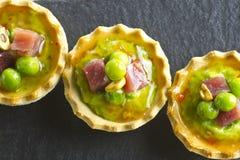 Peas with ham tapa Stock Image