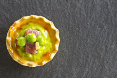 Peas with ham tapa Royalty Free Stock Image