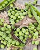 Peas with heart shape Stock Photos