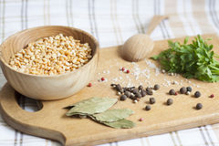 Peas, herbs and spices. Parsley, wooden spoon royalty free stock photos