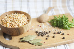 Peas, herbs and spices. Parsley, wooden spoon stock image