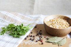 Peas, herbs and spices. Parsley, wooden spoon royalty free stock photography