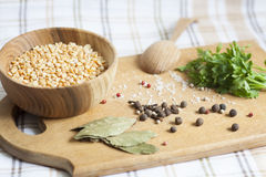 Peas, herbs and spices. Parsley, wooden spoon stock photos