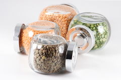 Peas and lentils. In containers Royalty Free Stock Photography