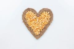 Peas lies at the heart made of burlap Stock Photos