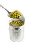 peas  in metal spoon Stock Photos