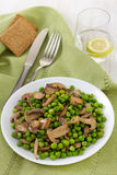 Peas with mushrooms with water Stock Photos