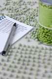 Peas with notepad Stock Photo