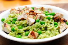 Peas pesto with fusilli and diced grilled chicken Royalty Free Stock Photos