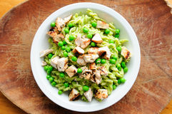Peas pesto with fusilli and diced grilled chicken Stock Photo